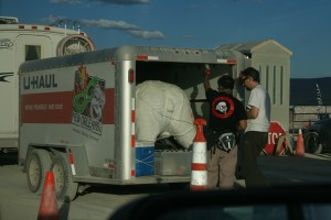 A Gate volunteer inspects an incoming vehicle and its trailer.  Polar bear = pass!